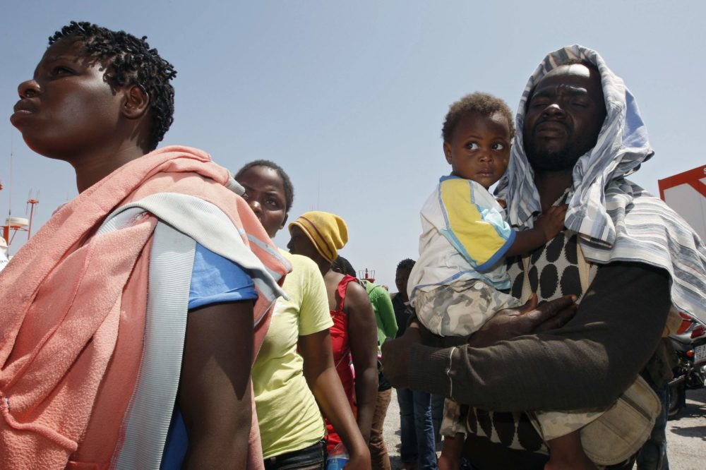 Would-be immigrants walk after arriving at the port of Motril